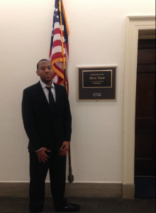 MSU TRIO SSS student Dellonie Davenport in front of Representative Dave Trott's office.