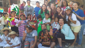 Janice (right in blue sweater, kneeling) with other volunteers in Oaxaca, Mexico.